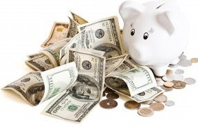 9565444-pile-of-money--piggy-bank-on-a-white-background