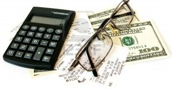 4887047-calculator-checks-and-dollars-on-white-background